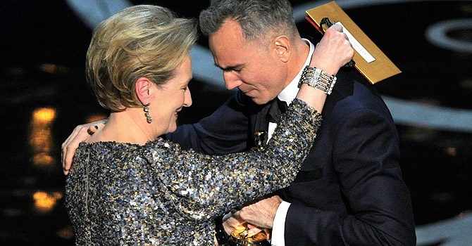 """Meryl Streep, left, presents the award for best actor in a leading role to Daniel Day-Lewis for """"Lincoln"""" during the Oscars at the Dolby Theatre on Sunday Feb. 24, 2013, in Los Angeles. — AP Photo"""