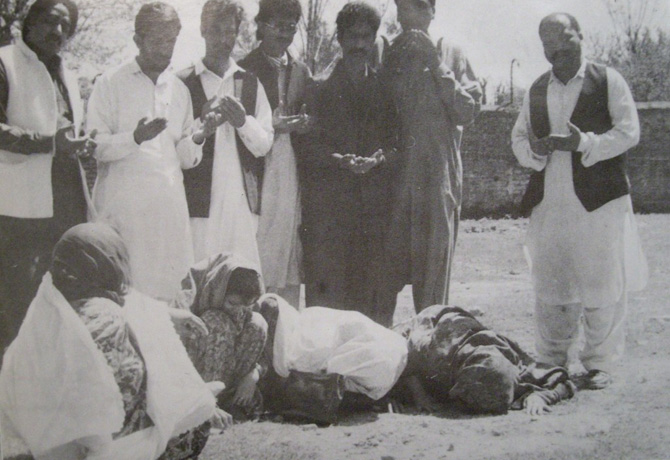 Men pray and women wail just outside the jail where Z A. Bhutto was hanged in April 1979. The picture was taken in May 1979.