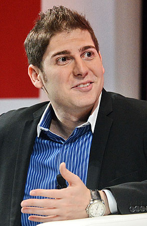 Facebook co-founder Eduardo Saverin speaks during the Wall Street Journal Unleashing Innovation executive conference held at Capella Singapore. —Photo by AFP