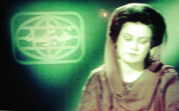 A woman newscaster reading the news on PTV in 1982. It was around this time that the government asked all women newscasters to cover their heads with dupattas.