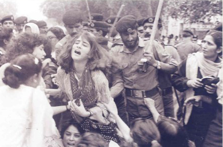 A woman's rally in Lahore protesting against the Zia dictatorship is baton-charged by the police (1980).