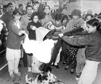 Disgusted by the Zia regime's 'moral policies,' woman activists burn their dupattas in Karachi (1981).