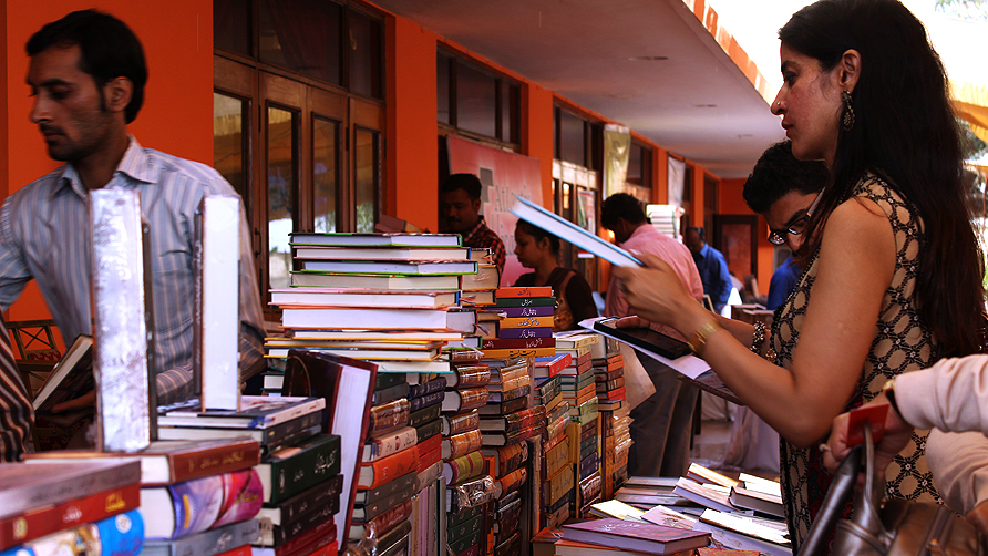 People browsing through books after the rain during KLF. - Photo by Shameen Khan/Dawn.com