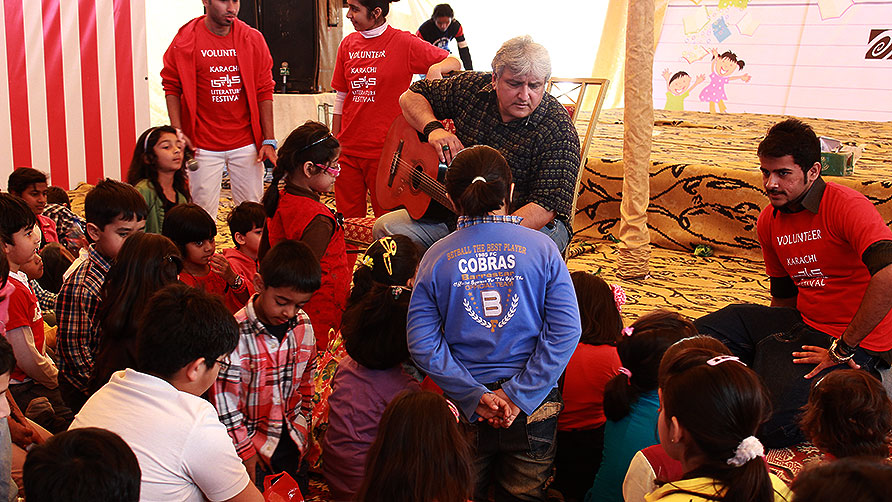 Khaled Anam sings with children at KLF. -Photo by Shameen Khan/Dawn.com