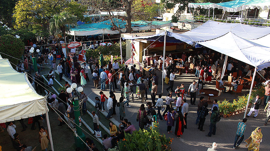 As today's sessions wrap up, people are busy buying books and food from the stalls. - Photo by Shameen Khan/Dawn.com