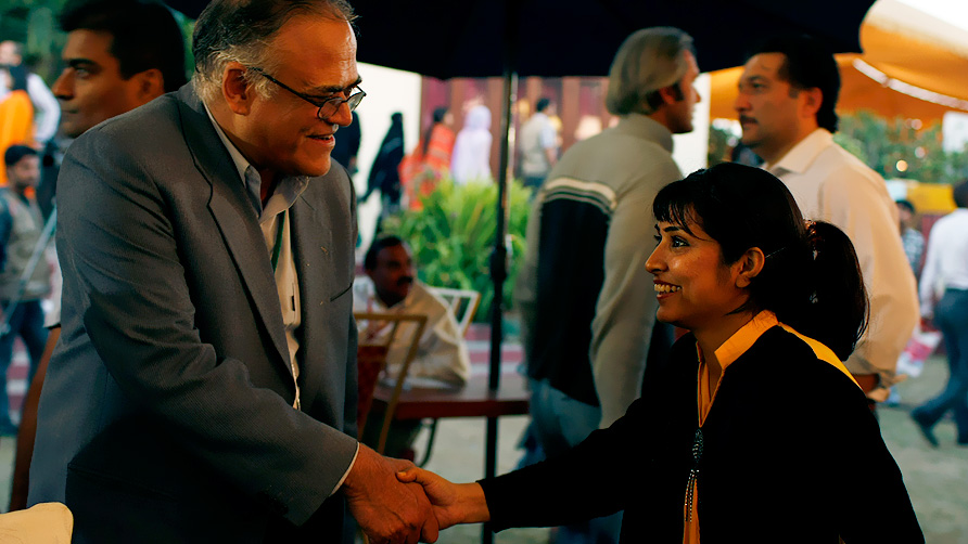 Javed Jabbar greets a fan. - Photo by Eefa Khalid/Dawn.com
