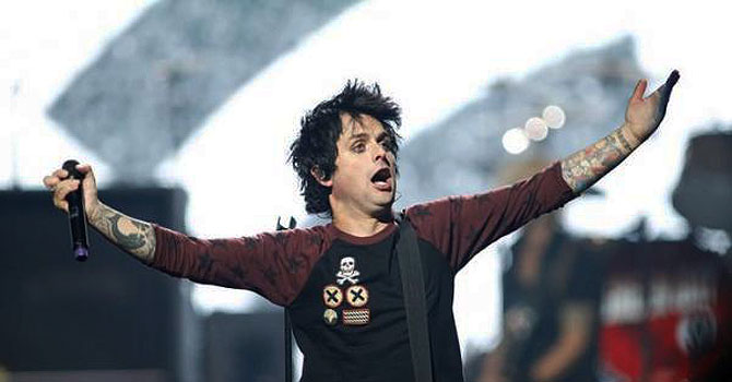Green Day lead vocalist and guitarist Billie Joe Armstrong performing during the 2012 iHeart Radio Music Festival before the onstage rant. —Photo (File) Reuters