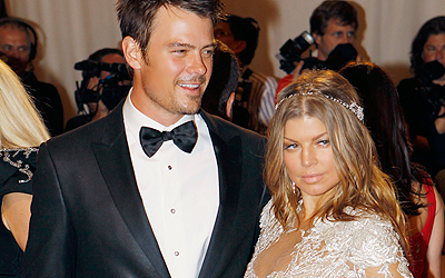 Actor Josh Duhamel and singer Fergie arrive at the Metropolitan Museum of Art Costume Institute Benefit celebrating the opening of Alexander McQueen: Savage Beauty, in New York, in this May 2, 2011, file photo. Fergie, the Black Eyed Peas singer announced her pregnancy on Twitter.com, February 18, 2013. REUTERS/Mike Segar/Files (UNITED STATES - Tags: ENTERTAINMENT FASHION)