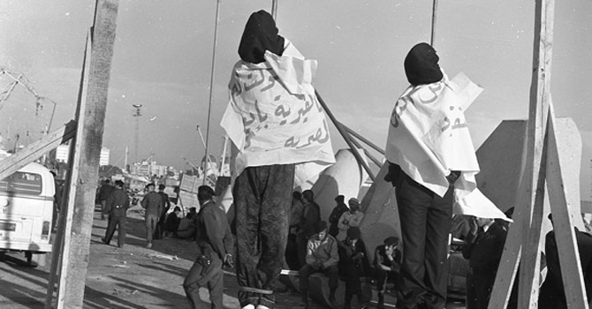 Two opponents of the Qaddafi regime hanged in public in 1977.
