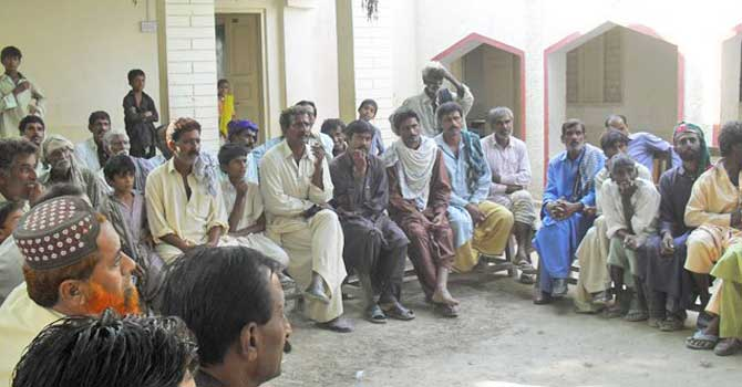 Men at the community meeting in Dadu. – File Photo