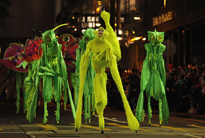 Performers from Australia's Empress Stiltdance perform during a Chinese New Year evening parade at Hong Kong's Tsim Sha Tsui shopping district.?Photo by Reuters