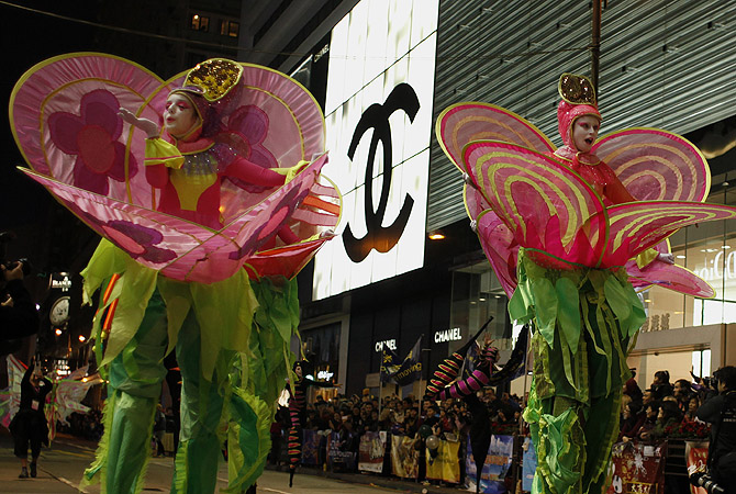 Performers from Australia's Empress Stiltdance participate during a Chinese New Year evening parade at Hong Kong's Tsim Sha Tsui shopping district. Participants from 14 countries and regions join the parade on Sunday to celebrate the first day of the Year of the Snake, according to the Chinese Zodiac.?Photo by Reuters