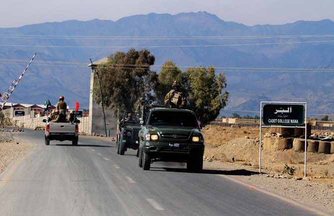 Soldiers drive through a road near Wana, the main town in Pakistan's South Waziristan tribal region bordering Afghanistan November 27, 2012. - Photo by Reuters