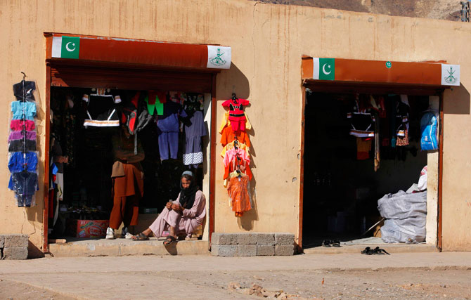 A man sits outside his shop at a market in Chagmalai in Pakistan's South Waziristan tribal region bordering Afghanistan November 29, 2012. - Photo by Reuters