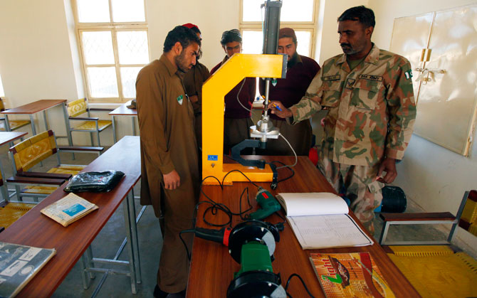 An army instructor teaches students at a technical class in the Waziristan Institute of Technical Education (WITE) in Spinkai in Pakistan's South Waziristan tribal region bordering Afghanistan November 29, 2012. - Photo by Reuters