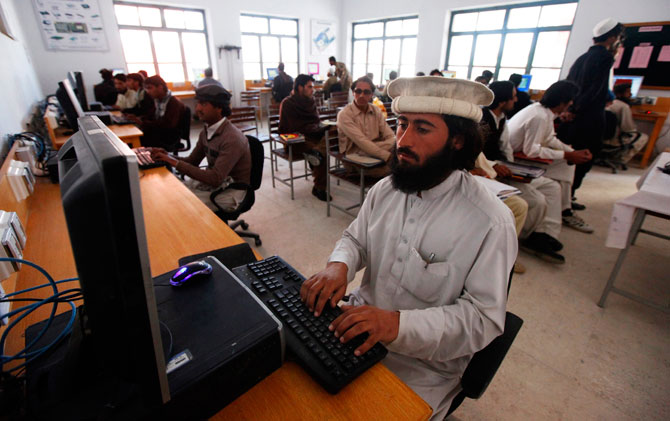 A man attends a computer class at the Wana Institute of Technical Training in Wana, the main town in Pakistan's South Waziristan tribal region bordering Afghanistan November 27, 2012. - Photo by Reuters