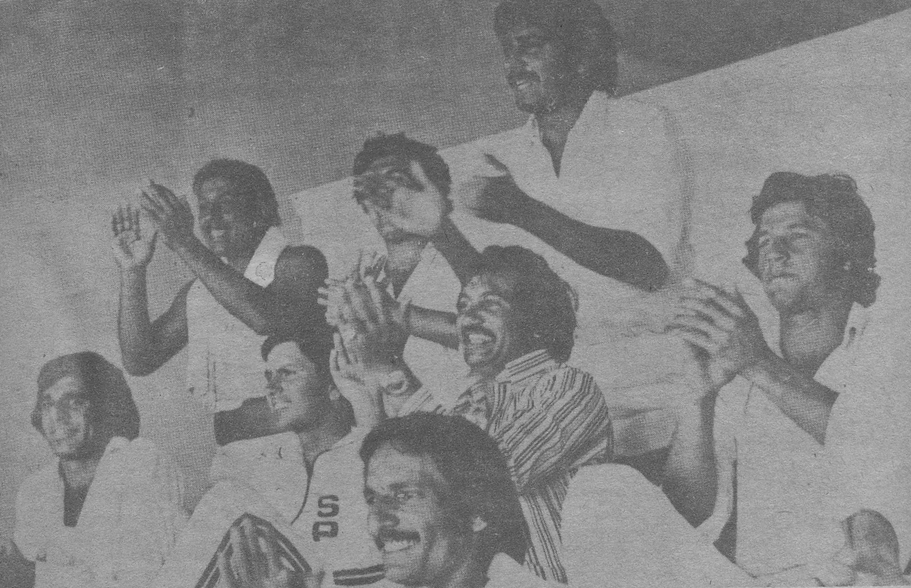 The Pakistan dressing room erupts with applause as Asif Iqbal reaches his century in Sydney. (From left [sitting]): Haroon Rashid, Majid Khan, Sadiq Muhammad, Taslim Arif and Imran Khan. (Standing from left): Saleem Altaf, Wasim Bari and Sarfraz Nawaz.
