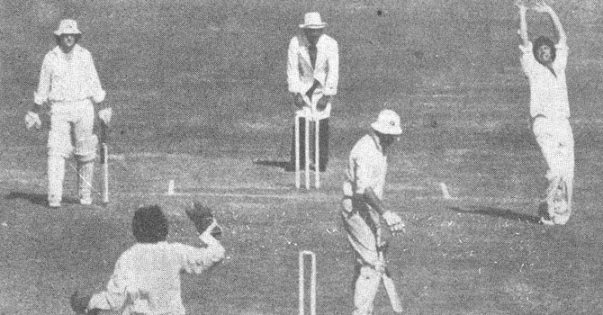 A 24-year-old Imran Khan uproots the stumps of a New Zealand batsman during the third Test in Karachi, 1976. Also seen in the picture is wicketkeeper, Wasim Bari.