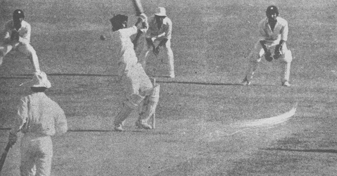 Javed Miandad swings but misses a delivery from Joel Garner, is hit on the pads and given out LBW. Asif Iqbal watches from the non-strikers end.