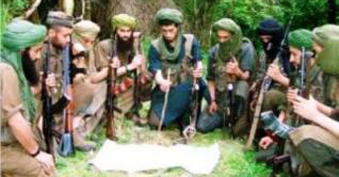 Algeria's Islamist guerilla fighters holding a meeting in 1996. Groups of militant Islamists went to war with the Algerian military between 1992 and 2002. Thousands of Algerians were killed in the conflict until the Algerian military finally managed to subdue the militants.