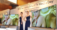 Models pose with Samsung Electronics' new 75 inch F8000 Smart LED TV during a media conference in Seoul on February 19, 2013. South Korea's Samsung Electronics on February 19 launched a set of giant, Internet-enabled televisions aimed at boosting profit margins and cementing its lead on the world's TV markets hit by slowing global demand. AFP PHOTO / JUNG YEON-JE