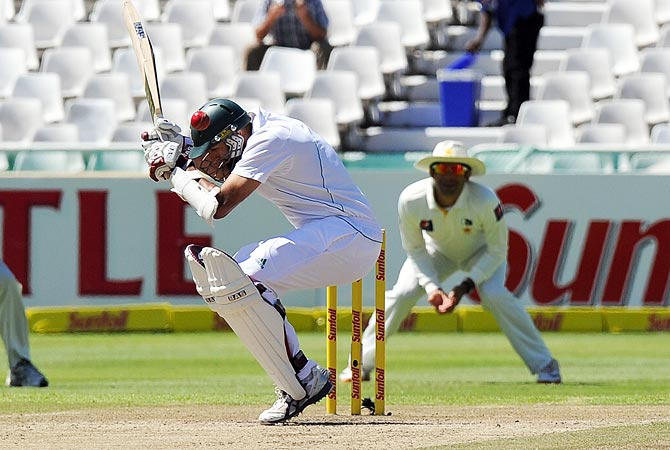 South African cricketer Hashim Amla avoids a bouncer. -Photo by AFP