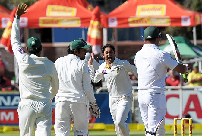 Pakistan cricketer Saeed Ajmal celebrates the wicket of South African Jacques Kallis. -Photo by AFP