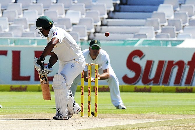 Pakistan cricketer Asad Shafiq looks back as he was caught out on 111 runs bowled by unseen South African cricketer Vernon Philander. -Photo by AFP