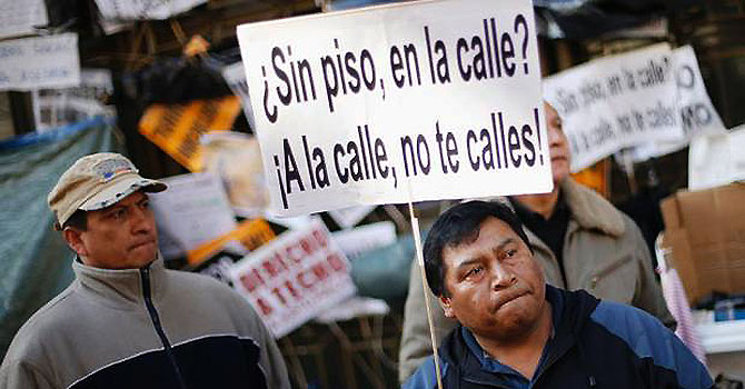 Suicides caused by eviction has angered public by what they see as a lack of compassion among Spanish banks.The placard reads 'Without flat, on the street? Take the street, do not be silent'. —Photo (File) Reuters