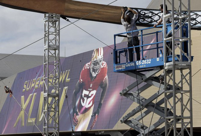 Workers build a structure outside the Mercedes-Benz Superdome on Monday, Jan. 28, 2013, in New Orleans. - Photo by AP