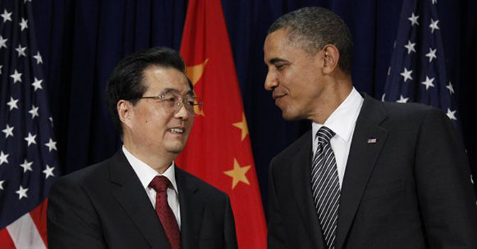 Former Chines Premier Hu Jintao meets Us President Barack Obama. — File Photo