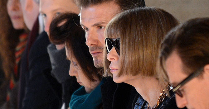 David Beckham (C) sits next to Vogue magazine editor Anna Wintour (2nd-R) at the Victoria Beckham show during the Mercedes-Benz Fashion Week Fall 2013 collections on February 10, 2013 in New York. AFP PHOTO/Stan HONDA
