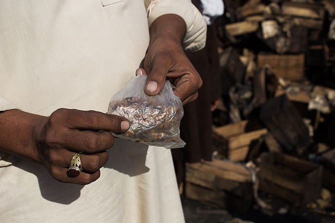 Shopkeeper Shahid Akbar could only retrieve his prayer beads from his shop, as everything else was burnt to ashes.