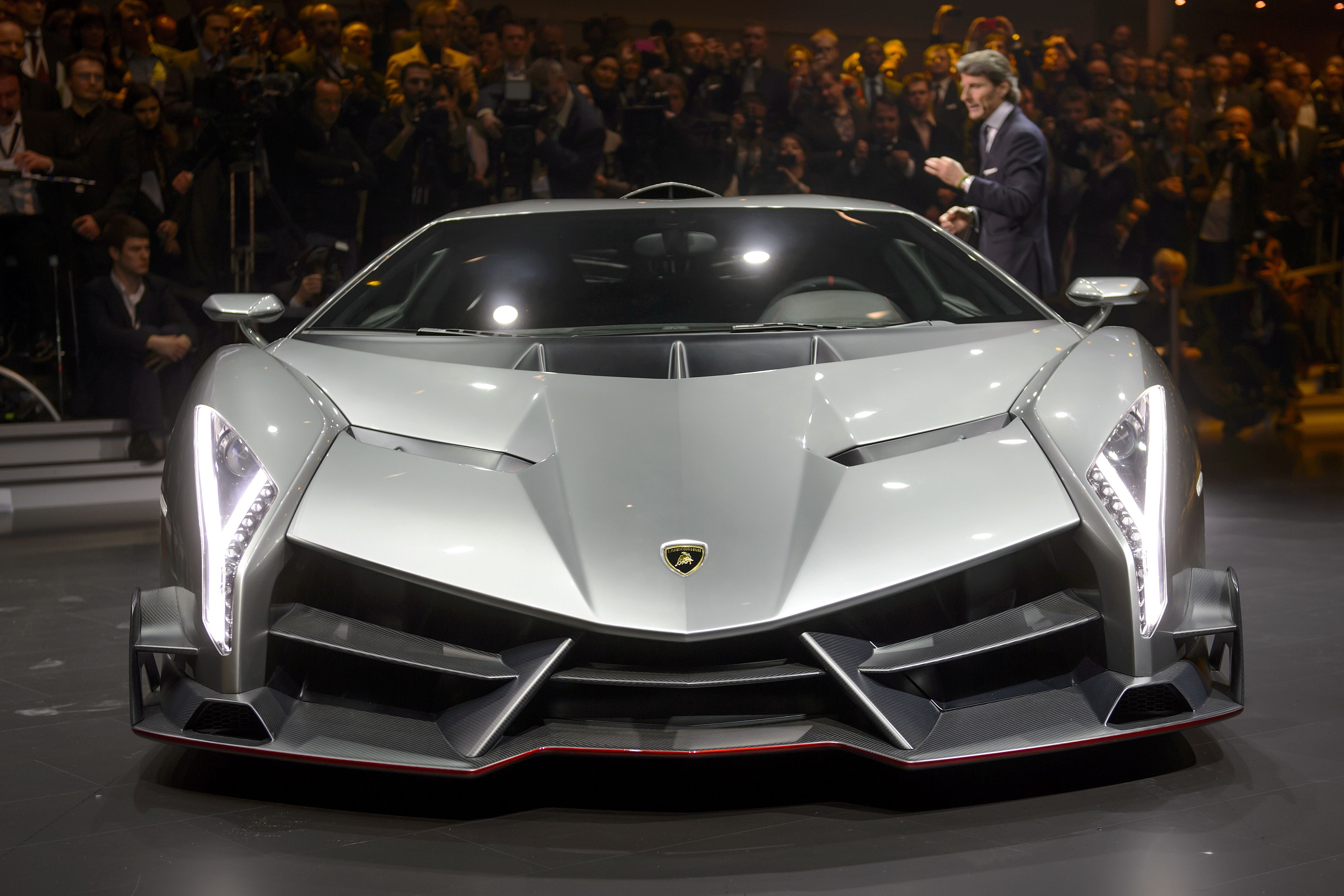 The new Lamborghini Veneno is introcuded by CEO and Chairman Stephan Winkelmann during a preview of Volkswagen Group (VW) on March 4, 2013 ahead of the Geneva Car Show in Geneva. AFP PHOTO / FABRICE COFFRINI