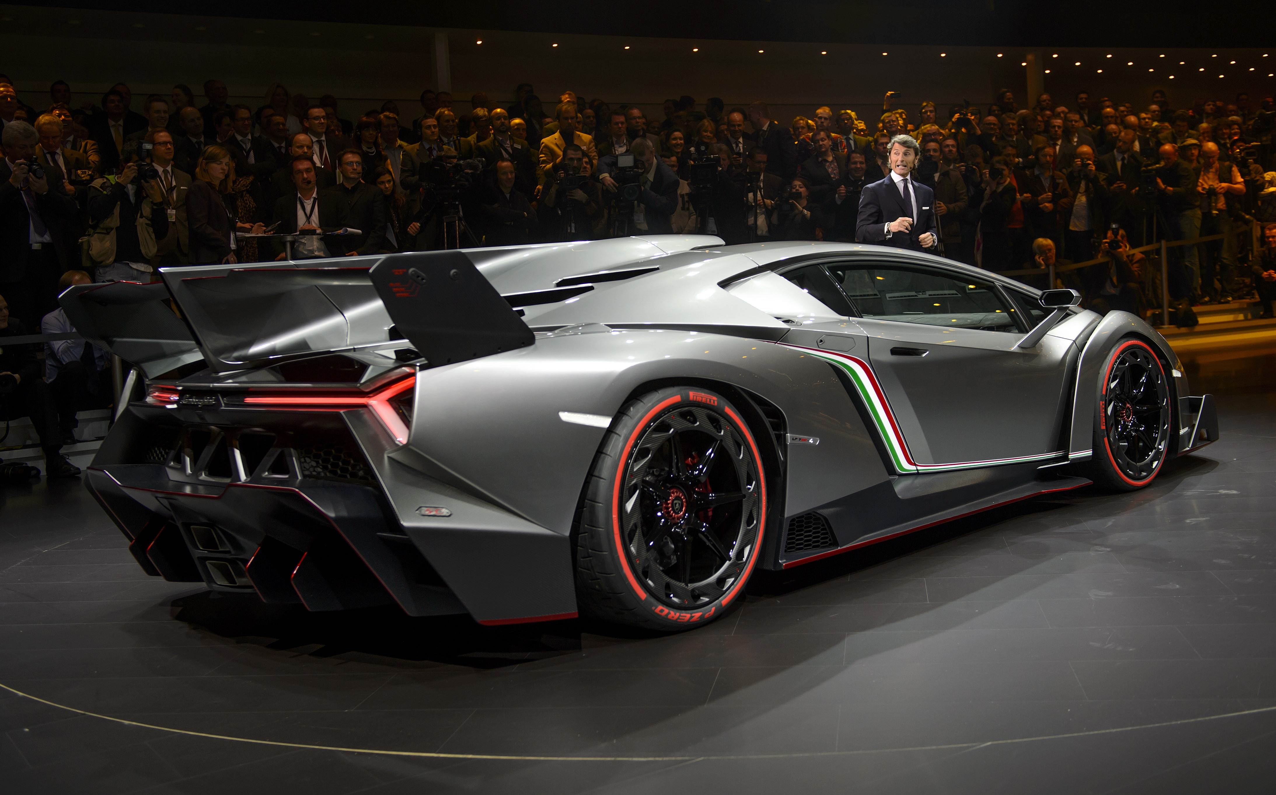 The new Lamborghini Veneno is introcuded by CEO and Chairman Stephan Winkelmann during a preview of Volkswagen Group on March 4, 2013 ahead of the Geneva Car Show in Geneva. AFP PHOTO / FABRICE COFFRINI