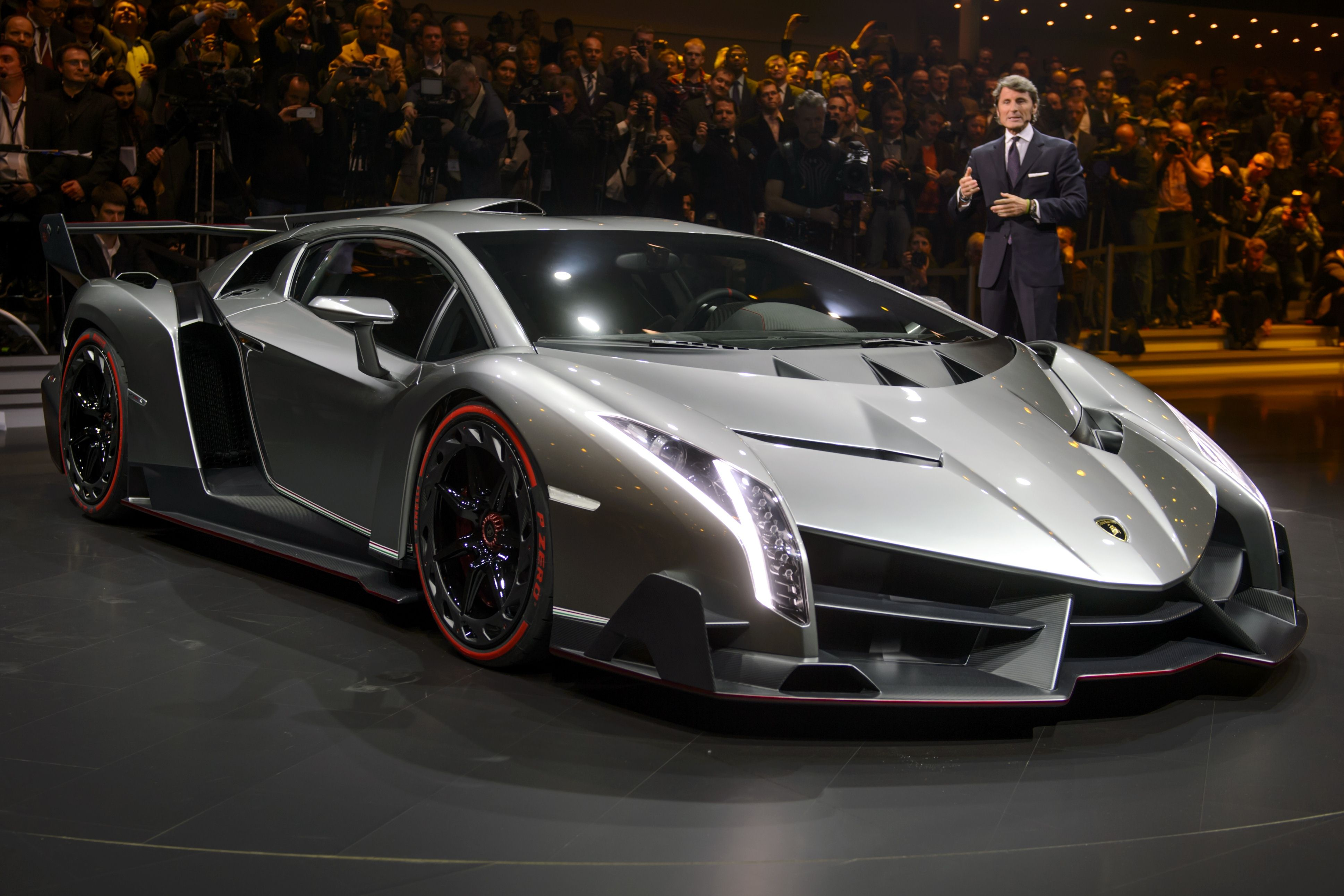 The new Lamborghini Veneno is presented by CEO and Chairman Stephan Winkelmann during a preview of Volkswagen Group on March 4, 2013 ahead of the Geneva Car Show in Geneva. AFP PHOTO / FABRICE COFFRINI