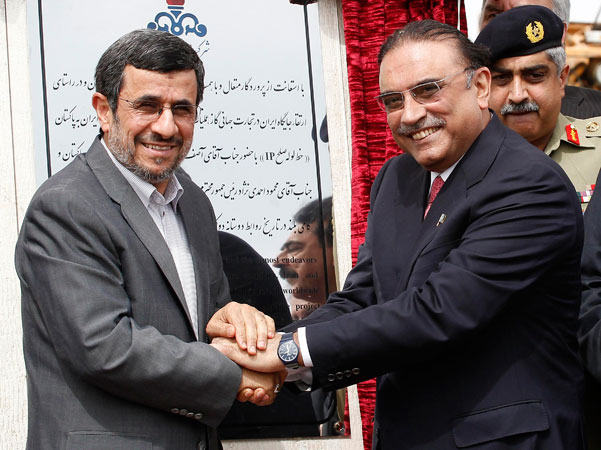 Iran's President Mahmoud Ahmadinejad (L) shakes hands with his Pakistani counterpart Asif Ali Zardari. ?Photo by Reuters
