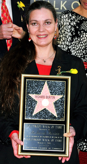 Maria Burton McKeown, daughter of Richard Burton and Elizabeth Taylor, poses with her father's star plaque. -AP Photo