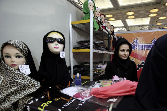 An Iranian woman attends the ?Second Fadjr International Fashion and Clothing Festival? at the Imam Khomeini grand mosque. ?Photo by AP