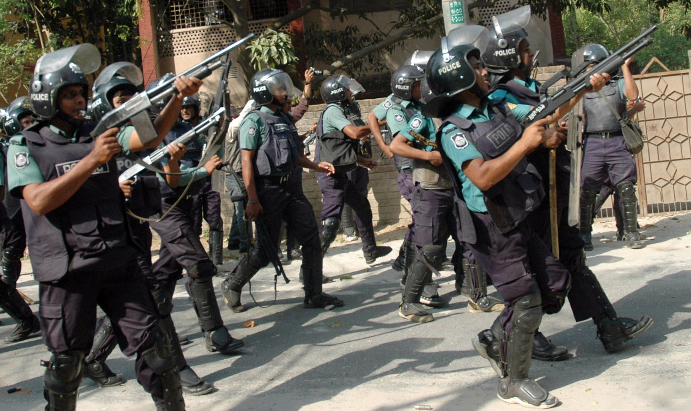 Police personnel march towards the activists of Jamaat-i-Islami, Bangladesh's biggest Islamist party, during a clash in Rajshahi. ? Photo by Reuters