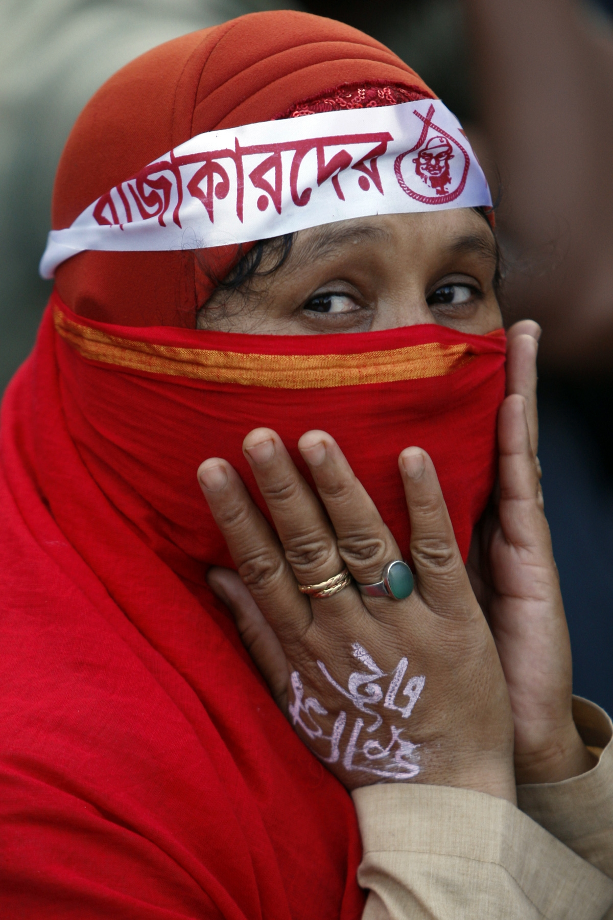 A Bangladeshi woman attends a protest rally in Dhaka. ? Photo by AP