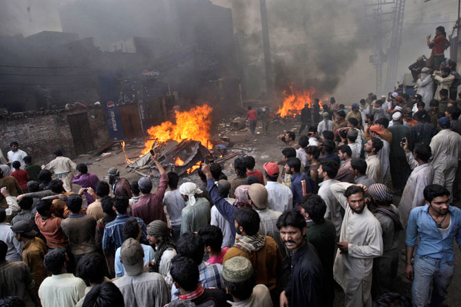 An angry mob gathers after burning Christian houses, Lahore, March 9, 2013.