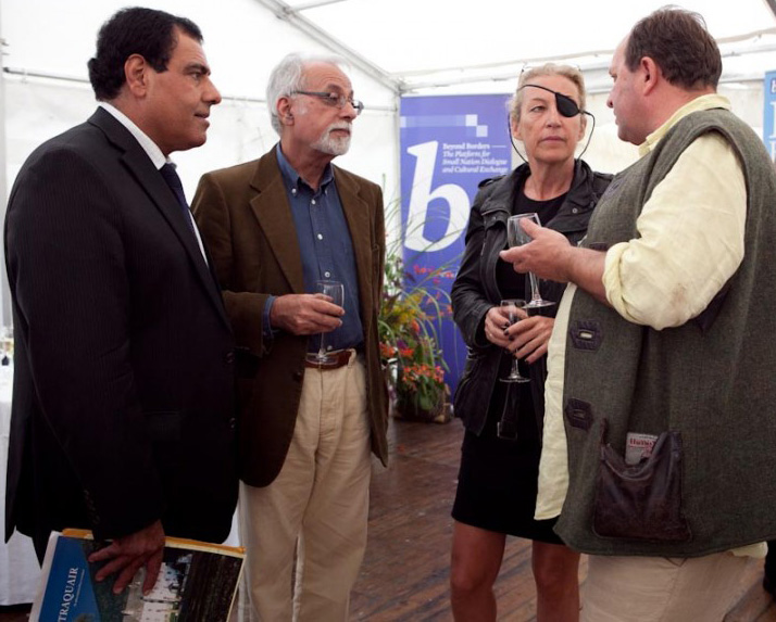 Rashid Rehman (second from left) in conversation with British author William Dalrymple (right) in 2012.
