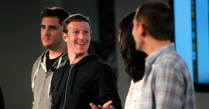 Zuckerberg gestures to members of the News Feed design team. —Photo by Reuters