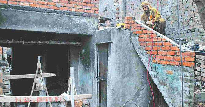 LAHORE: Repair work in progress in Joseph Colony. - Photo by White Star