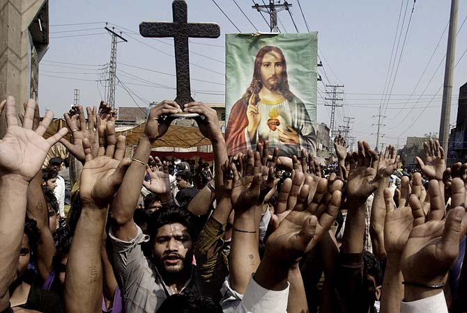 Protesters raise their hands during a demonstration in Lahore, March 10, 2013. ? Photo by AP