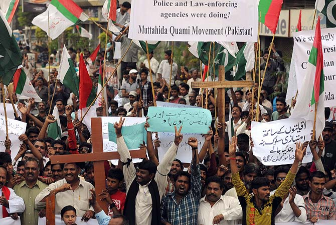 Protesters shout slogans during a protest against the attack on the homes of members of the Christian community by a mob, Karachi, March 10, 2013. ? Photo by AFP