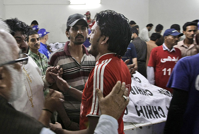 A man, who lost a relative in a bomb blast, reacts at a hospital's morgue in Karachi, Pakistan, Sunday, March 3, 2013.?Photo by AP
