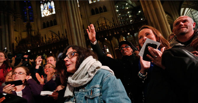 Americans watch the announcement of newly elected Pope Francis at St. Patrick's Cathedral in New York. —Photo by Reuters