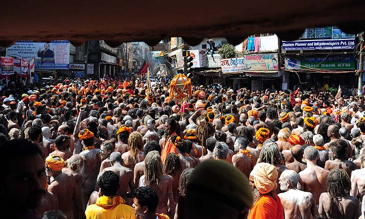 Naga sadhus - Hindu holy men - take out a religious procession to offer holy water from the Ganga river at the Kashi Vishwanath Temple in Varanasi on the occasion of Maha Shivaratri and the last day of the Kumbh.?Photo by AFP